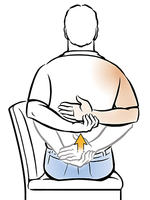 Man sitting in chair doing internal rotation shoulder exercise.