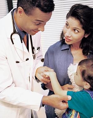 Woman with toddler talking to doctor.