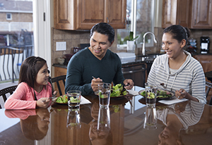 Family eating a healthy meal together