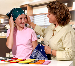 Woman and teenage girl shopping for head scarves.
